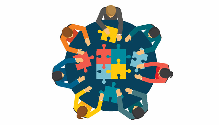 Seven people puzzling together their shareholder agreement