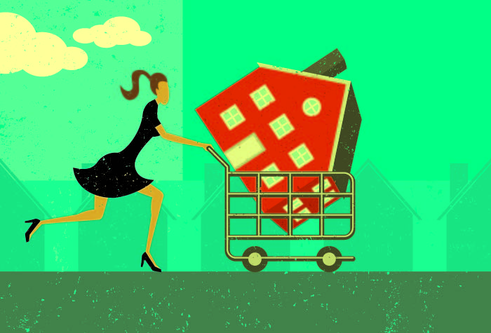 Woman running with a trolley containing her newly purchased house
