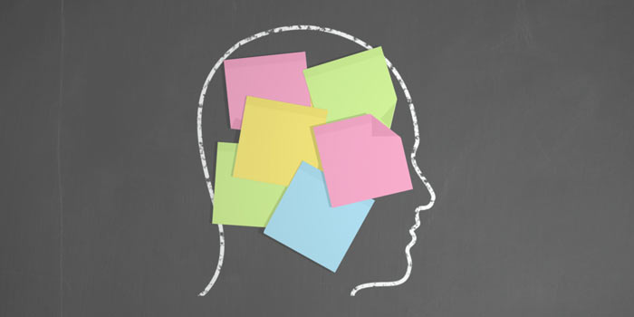 A person knowing the main points of a contract by heart, shown by sticky notes on his head, because of a clear Aide Memoirs, set up by the experienced construction lawyers of Gavel and Page.