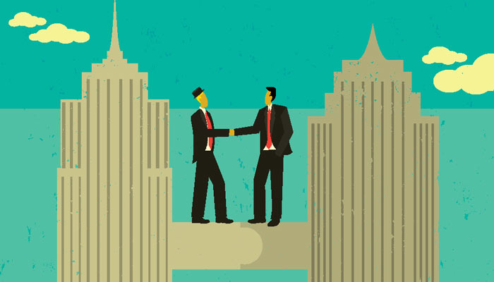 A property developer and a highly experienced Gavel and Page strata lawyer shaking hands as the strata lawyer gives him guidance over the large number of units the man has in his high buildings